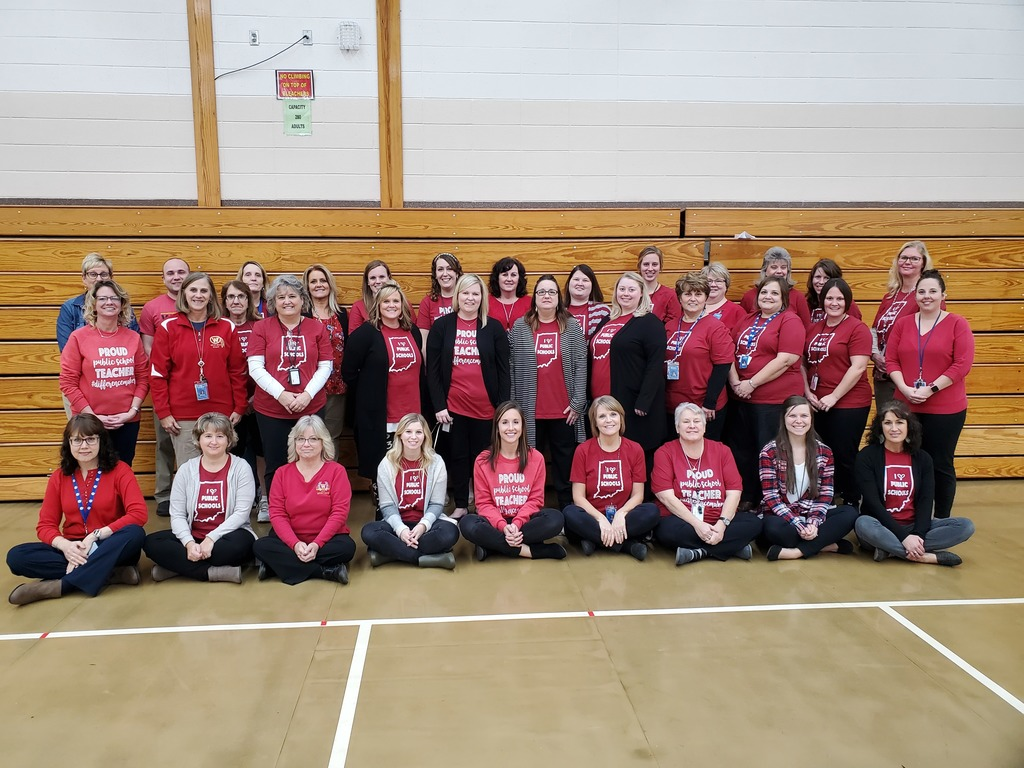 Topeka Staff dressed in red to support public education.