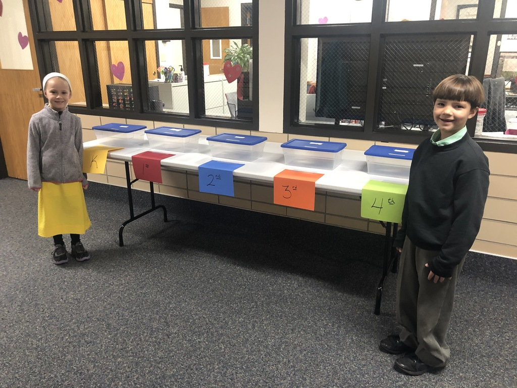 Students with collection boxes.