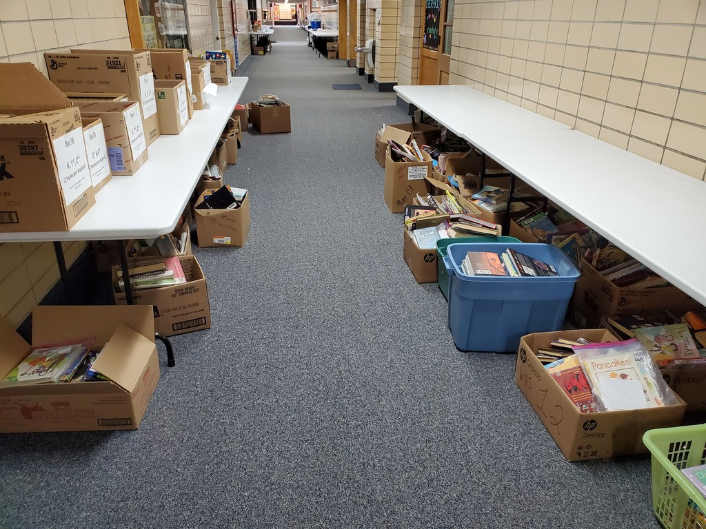 Returned library books line the hallway.