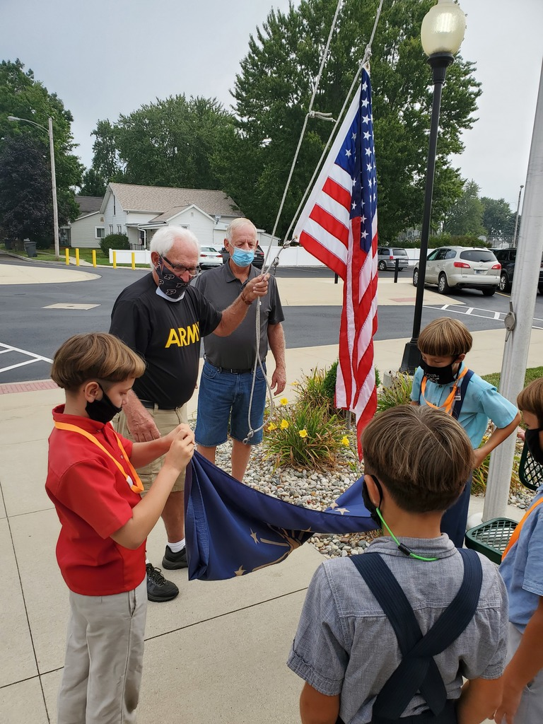 Veterans instructing flag etiquette